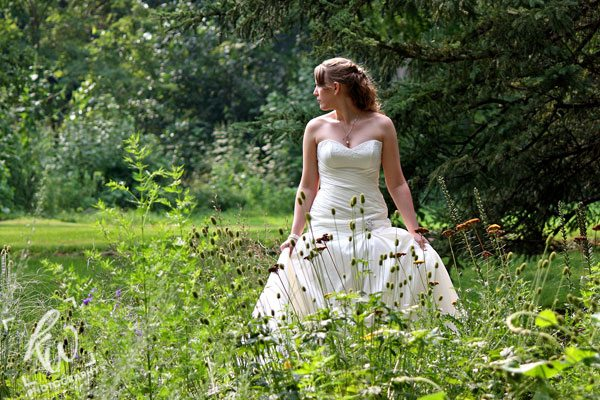 Wedding photography of bride in flower garden.