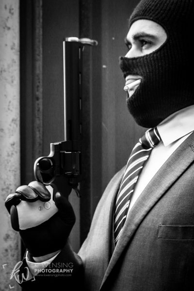 The TF2 Spy poses with his revolver.