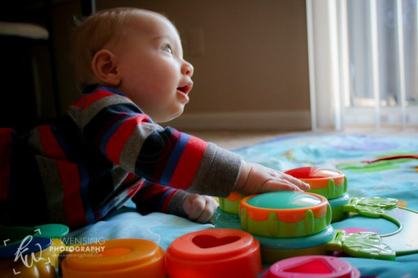 Gabriel amazed by the musical toy.