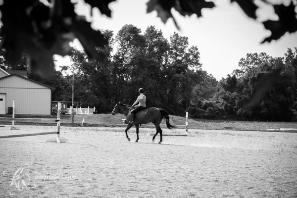 A girl riding her horse bareback around the track.