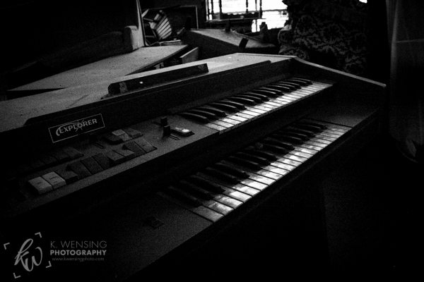 A piano left behind to gather up dust.