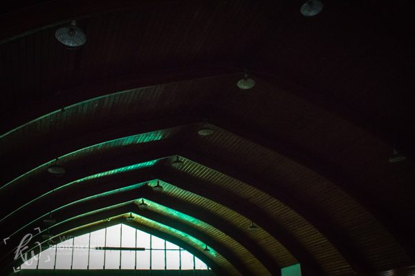 Beautifully arched ceiling of an abandoned gym.