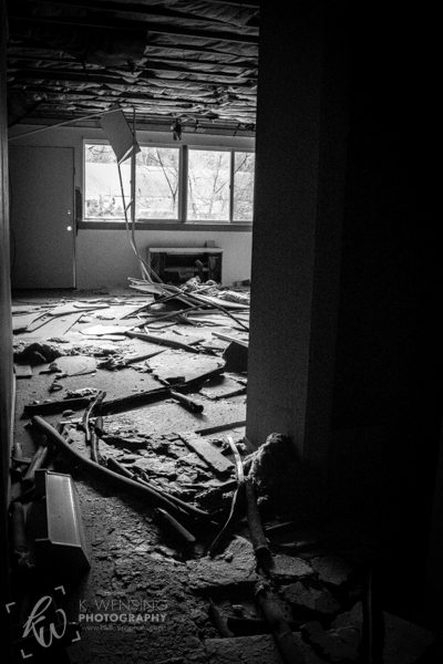 Black and white photography of abandoned room.
