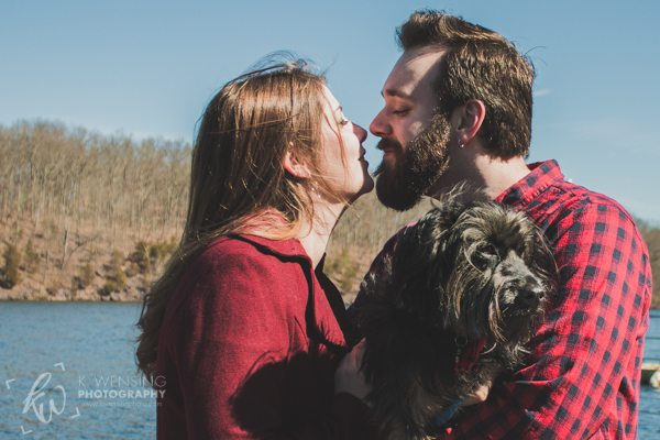 Engaged couple with their adorable dog.