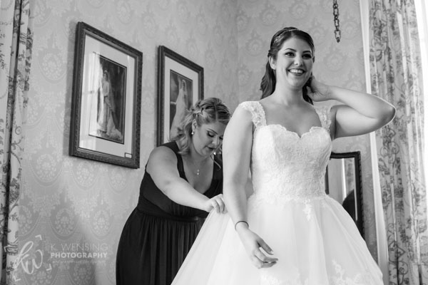 Sister of the bride helping her get ready.