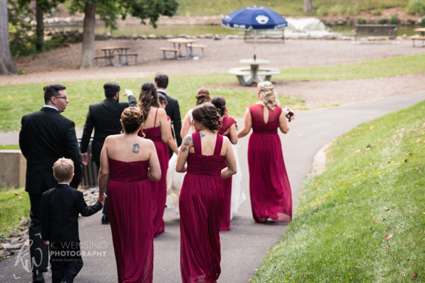 Following behind the bridal party.