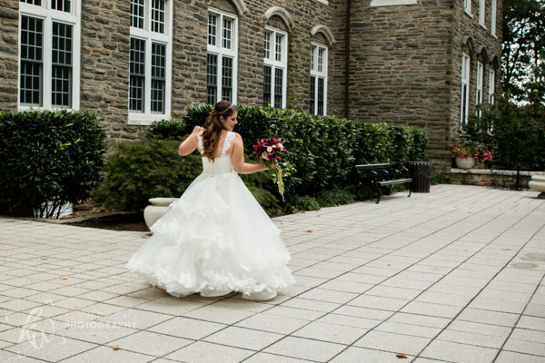 Twirling bride shows off her lovely dress.