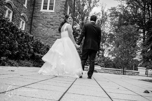 Young woman walks with her new husband.