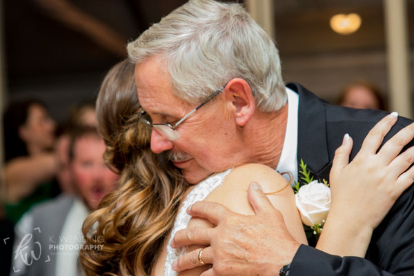 Father-of-the-bride embracing his daughter.