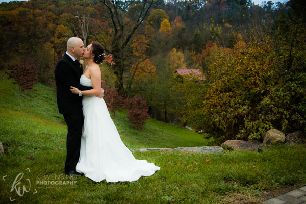Bride and groom share a kiss.