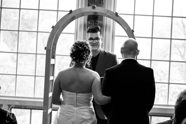 Black and white image of the officiant acknowledging the couple.