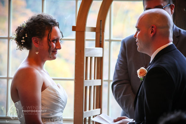The beautiful bride smiles at her soon-to-be husband.